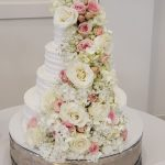Cascade of Roses on Wedding Cake